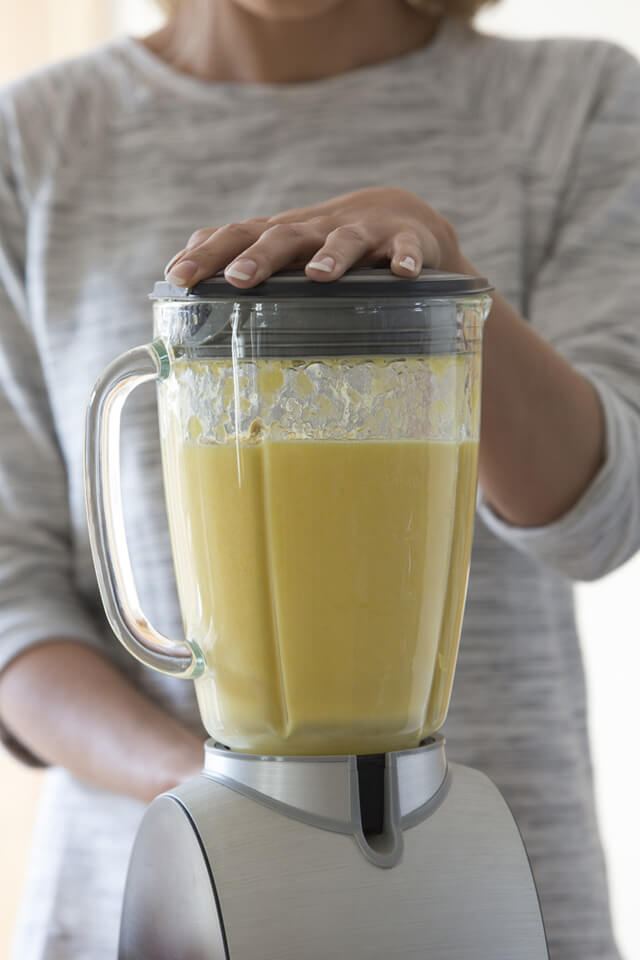 A smoothie of bananas is being blended
