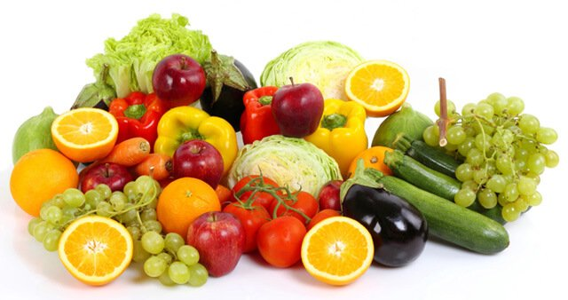 Fruits and vegetables in a large pile on a white background