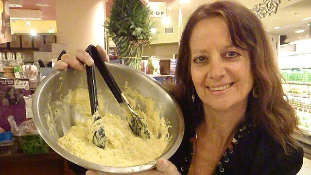 Karen Ranzi holds up a dish at a recipe demonstration