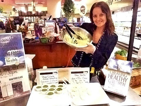 Karen Ranzi holds up a dish at a recipe demonstration