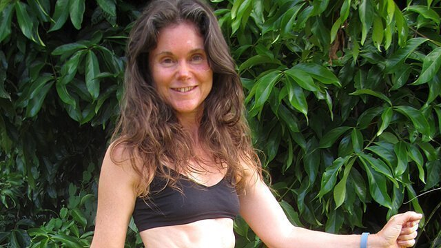 Janie Gardener smiles with arms raised