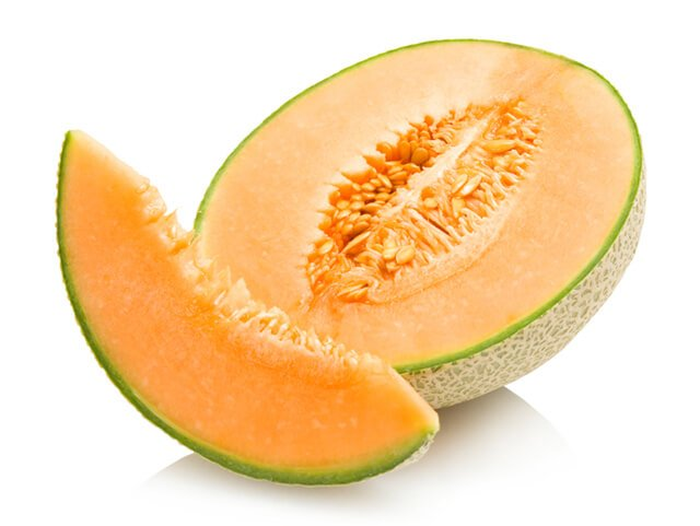 Cantaloupe sliced and halved against a white background