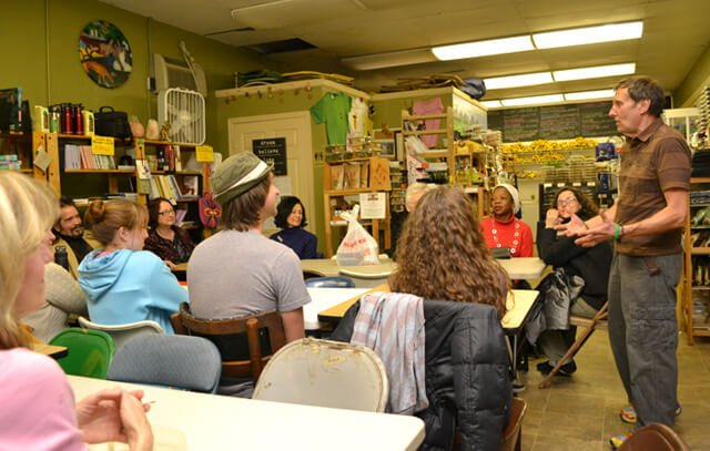 Arnold's Way owner Arnold Kauffman addresses potluck gatherers in February 2013