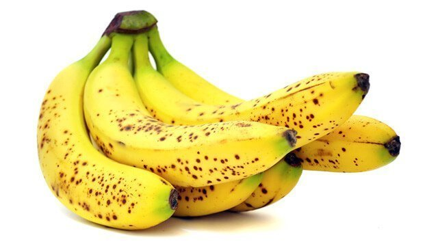 A hand of bananas on a white background