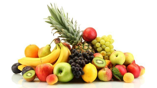 Apples, bananas, grapes and other fruits against a white background