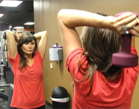 Megan Elizabeth exercises her triceps