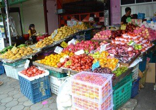 Brightly colored fruits tease the eye at Muang Mai Market in Chiang Mai, Thailand