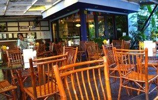 The beautiful, inviting patio section at Rasayana Raw Café in Bangkok, Thailand