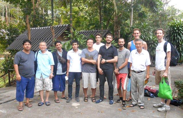 Men are photographed on the last day of a Vipassana meditation retreat in Kanchanaburi, Thailand