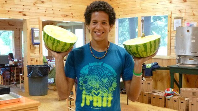 Kevin Rogers holds watermelon halves at The Woodstock Fruit Festival