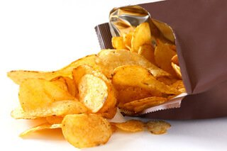Potato chips spilling out of a bag