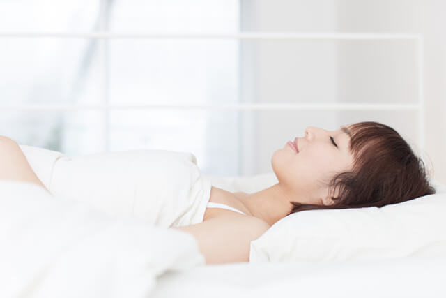 Asian woman at rest in bed