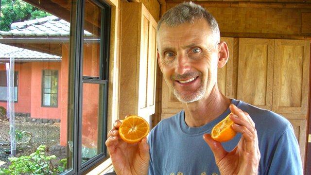Don Weaver holds orange halves
