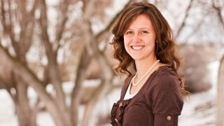 Jessica Fuller photographed with a snowy background.