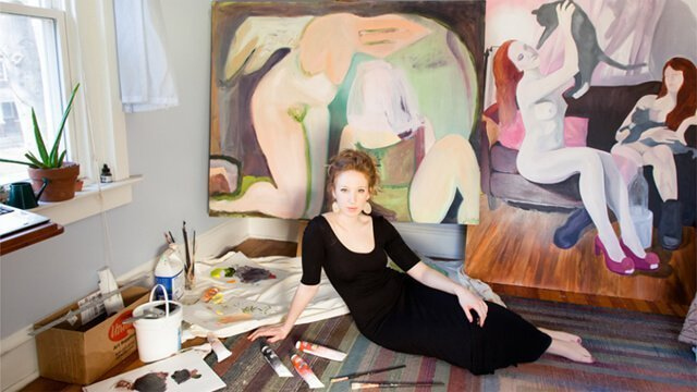 Jessica Thim poses with paintings in her room