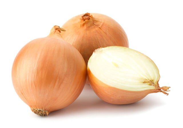 Two-and-a-half onions against a white background