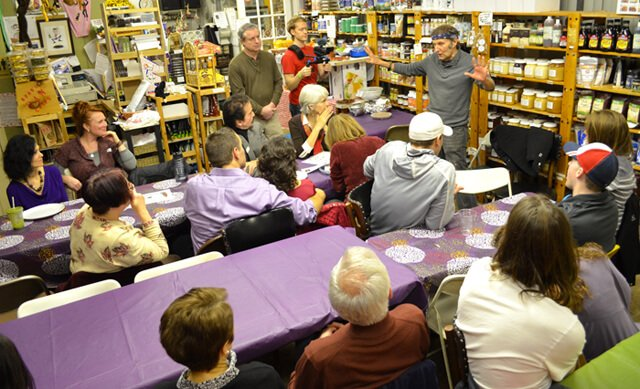 Patrons listen to Arnold Kauffman at an Arnold's Way potluck