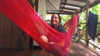 Jenee Hallick sits on a hammock