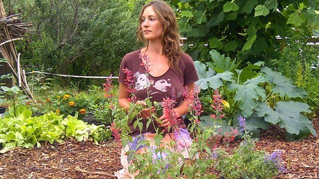 Julie Kersey sitting on her knees in a garden