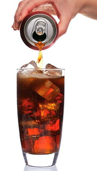 Cola being poured against white background