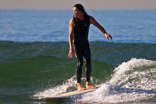 Ryan Lum on a surfboard