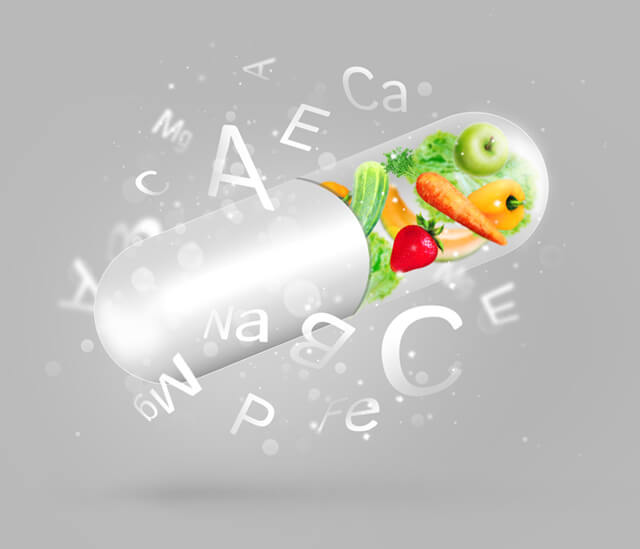 Fruits and vegetables in a vitamin capsule with vitamin names