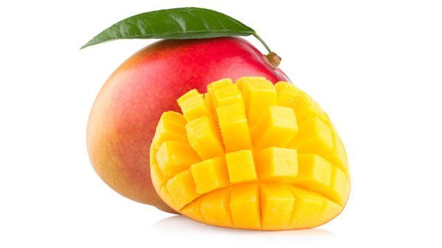 One whole mango and a cut half of mango against a white background