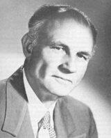 Headshot of Herbert M. Shelton