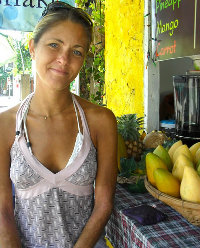 Louise Koch smiles at a smoothie bar