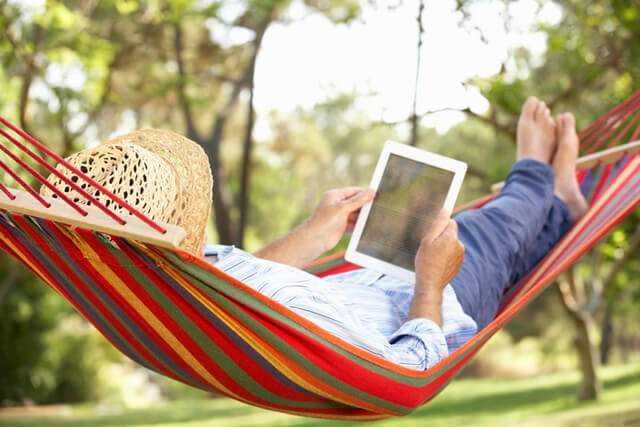 Man reading on a hammock