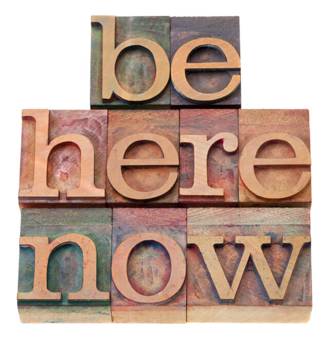Be here now in block letters
