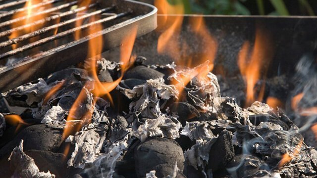 An open barbecue grill flame