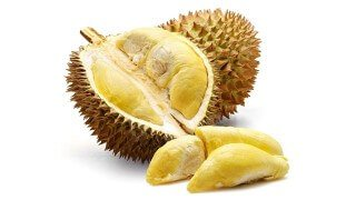 """Durian opened with """"meal"""" exposed against a white background"""