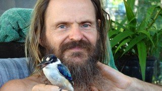 Mango Wodzak photographed with a bird