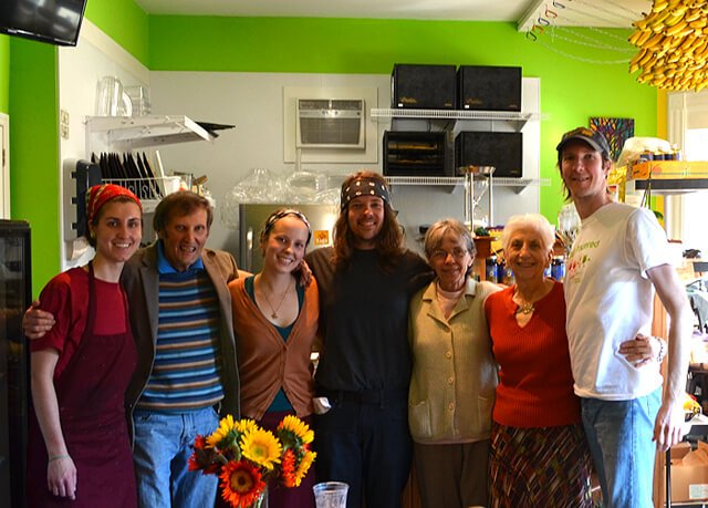 Arnold's Way community members pose for a photograph with the Nucleus Raw Foods crew in April 2014