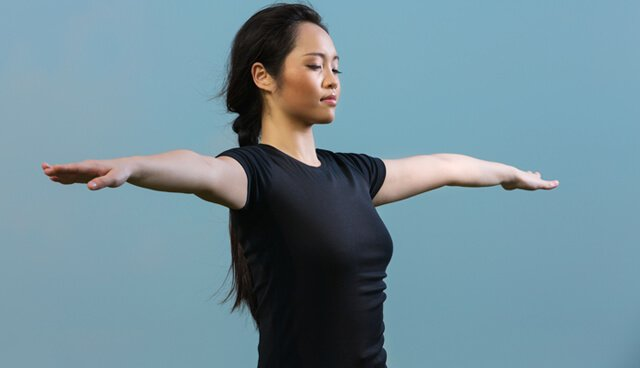 Chinese woman holding a yoga position
