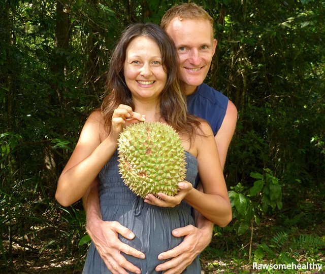 Yulia and Paul Tarbath holding a durian while pregnant