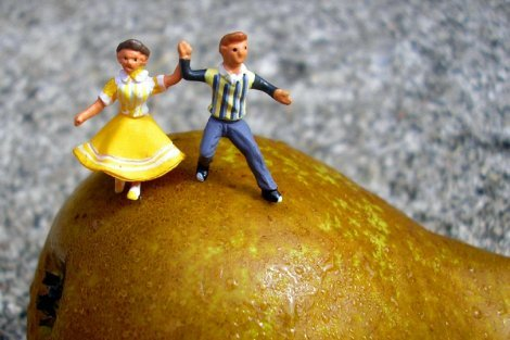 Fruit art by Anne Osborne - a man and woman dance on a pear - Fruit-Powered