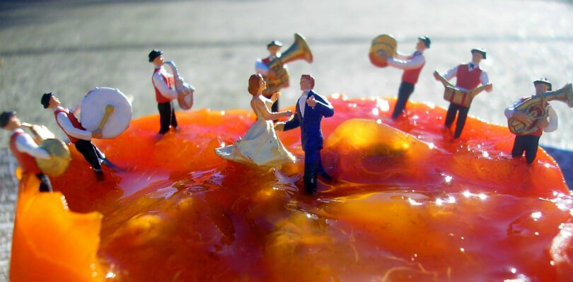 Fruit art by Anne Osborne - men and women enjoy song and dance over a persimmon - Fruit-Powered