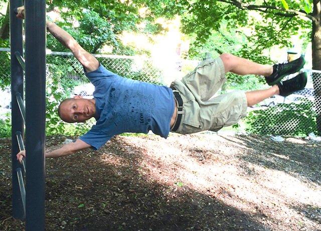"""Rob """"Freedomfighter"""" Rehnmark hangs sideways from beams"""