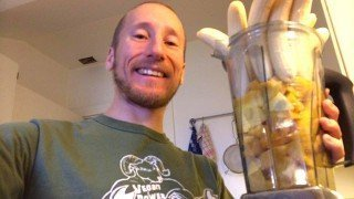 Rob Rehnmark showing a blender container full of bananas and mangos