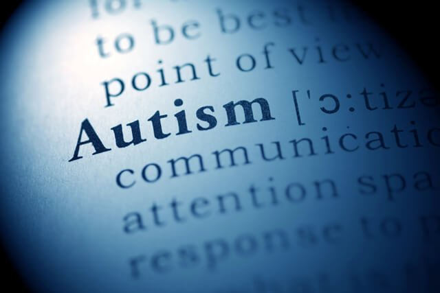 "The word ""autism"" spotlighted in a dictionary"