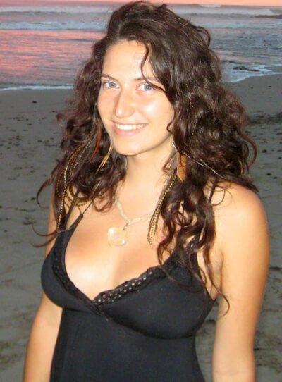 Gabriela Ranzi poses in a dress on a beach