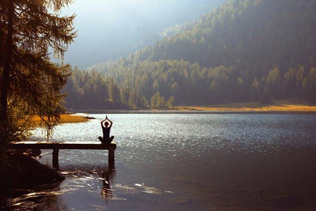 Meditation on a lake on a sunny day