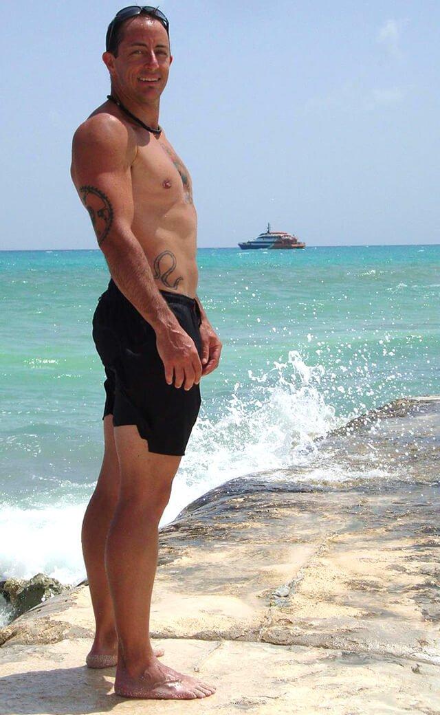 Victor VanRambutan poses on a sunny day at a beach
