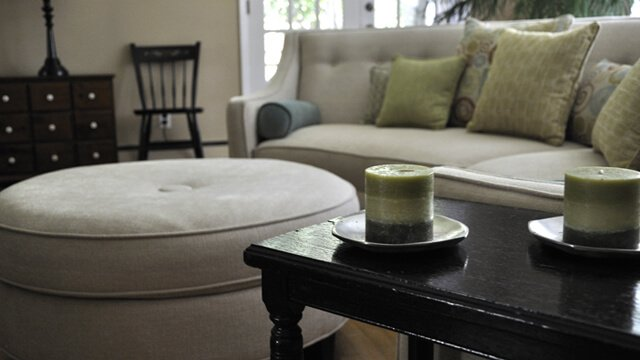 Candles and stain on tables and hardwood floor