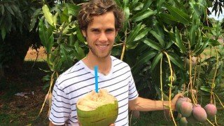 Robby Barbaro holds a coconut outside