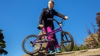 Timothy Radley looks into the distance beside his BMX bicycle