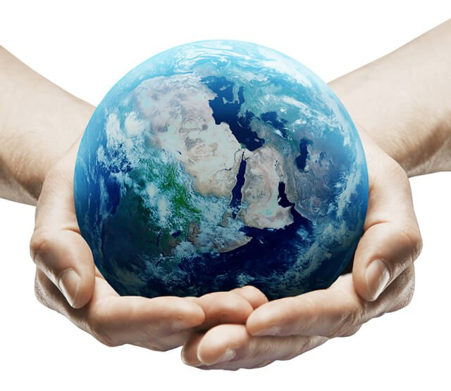 Hands holding earth against a white background