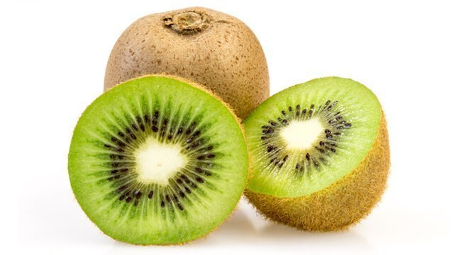 Kiwi in halves and whole against a white background
